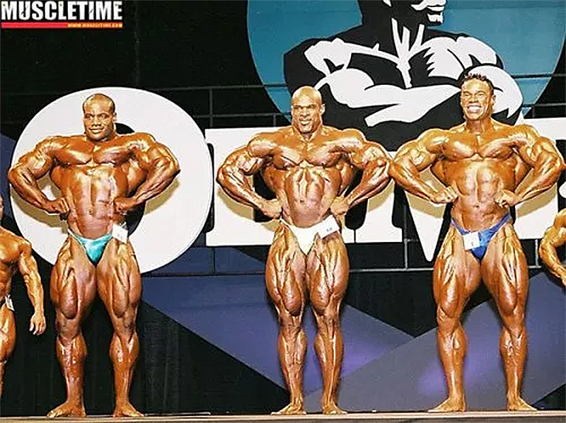 2002 Mr. Olympia: from left; Chris Cormier (3rd), Ronnie Coleman (1st), Kevin Levrone (2nd).
